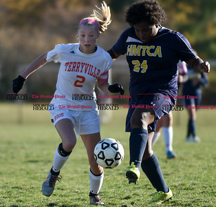 100716  Wesley Bunnell | Staff  Terryville captain Jenna Covello (2) fights for the ball in a Class S first round girls soccer tournament game against HMTCA on Monday afternoon at Terryville High.