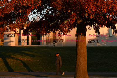 100716  Wesley Bunnell | Staff  Walkers wind through the warm late afternoon autumn sun at Walnut Hill Park on Monday.