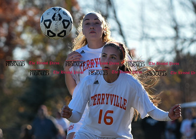 100716  Wesley Bunnell | Staff  Terryville's Sydney Lopes (16) and teammate track down a loose ball in their Class S first round girls soccer tournament game against HMTCA on Monday afternoon at Terryville High.
