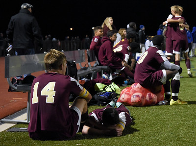 110816  Wesley Bunnell   Staff  New Britain boys soccer players comfort each other after their first round class LL loss against Hall in a match played at Hall High School on Tuesday evening.