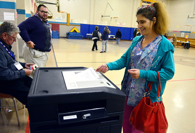 11/8/2016 Mike Orazzi   Staff Cindy Goergen casts her votes at the South Side School in Bristol Tuesday.