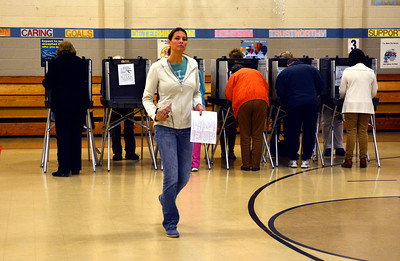 11/8/2016 Mike Orazzi   Staff Melody Theriault casts her votes at the South Side School in Bristol Tuesday.