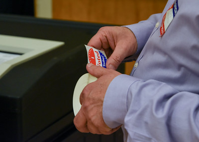 110816  Wesley Bunnell   Staff  Tabulator Tender Mike Bracken hands out I Voted stickers at New Britain High School during the Tuesday election.
