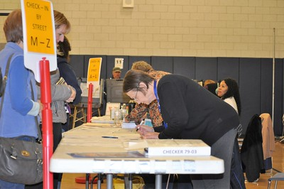 11/8/2016 EVE BRITTON/Staff Voters get ballots from busy poll workers at Greene-Hills School Tuesday.