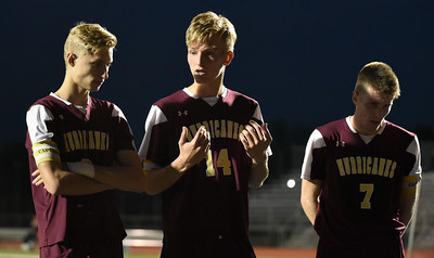 110816  Wesley Bunnell   Staff  Senior Defenseman Nikodem Jarmoszko (14) encourages his teammates during the half of the New Britain boys soccer game vs Hall in the first round of the LL bracket.