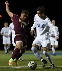110816  Wesley Bunnell   Staff  Senior Forward Drake Robinson #11 fights for the ball during the New Britain boys soccer class LL first round match against  Hall at Hall High School on Tuesday evening.