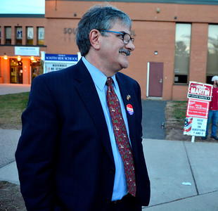 11/8/2016 Mike Orazzi   Staff Mike Nicastro greets voters at the South Side School in Bristol Tuesday.