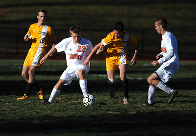 11/8/2016 Mike Orazzi   Staff Terryville's Ethan Rheault (22) and Derek Thibodeau (7) with Thomaston's Marc DiBeneditto (4) during the Class S First Round Soccer Tournament at THS Tuesday.