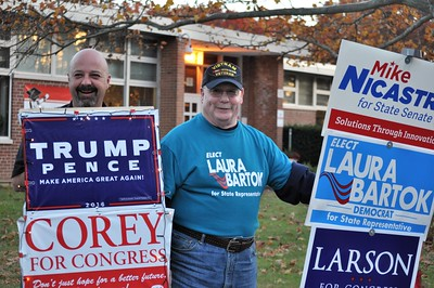 11/8/2016 EVE BRITTON/Staff Henry Raymond Jr. and Tim Gamache while doing last-minute canvassing Tuesday at Greene-Hills School.
