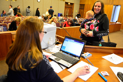 11/8/2016 Mike Orazzi   Staff Sheena Ojeda and her daughter Lily while registering to vote at Bristol City Hall Tuesday.