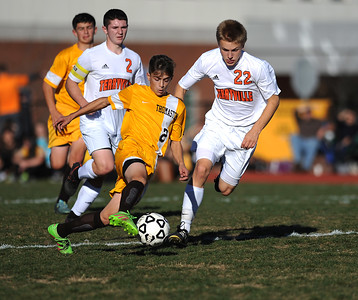 11/8/2016 Mike Orazzi   Staff Thomaston's Mergim Kutllovci (2) Terryville's Ethan Rheault (22) during the Class S First Round Soccer Tournament at THS Tuesday.