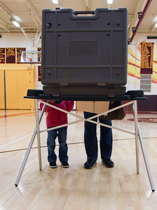 110816  Wesley Bunnell   Staff  Deborah Edney, shown right, votes at the District 2 voting location Tuesday afternoon at New Britain High School with Kerni Edney age two.