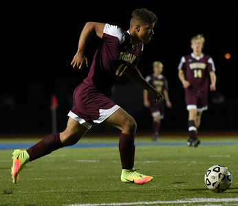 110816  Wesley Bunnell   Staff  Senior Forward Drake Robinson #11 takes the ball upfield against Hall during the New Britain boys soccer class LL first round match played at Hall High School on Tuesday evening.