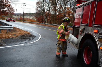 11/9/2016 Mike Orazzi | Staff A  closed James P. Casey Road at the intersection with Clark Avenue and Minor Road for an oil slick Wednesday afternoon.