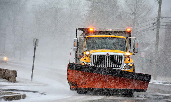 1/23/2016 Mike Orazzi | Staff A Bristol city plow truck on Lake Avenue during Saturday's snow storm.