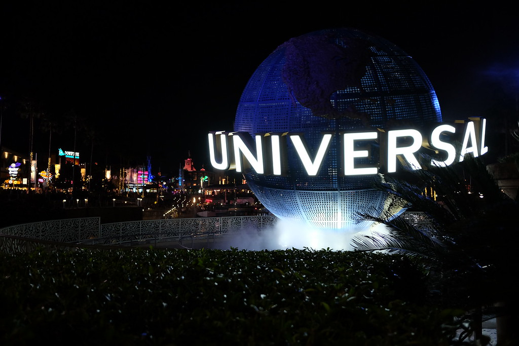Universal Orlando resort globe lit up at night