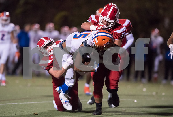 11/3/17 Wesley Bunnell   Staff Bloomfield vs Berlin football on Friday night at Sage Park. James Mozzarella (2) and Greg Carson (54) on the tackle.