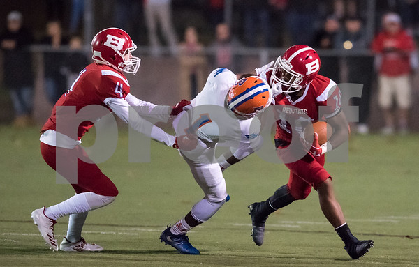 11/3/17 Wesley Bunnell   Staff Bloomfield vs Berlin football on Friday night at Sage Park. Andrew Brochu (4) and Larry St. Pierre Jr with the ball as he is face masked. A penalty would be called on the play.