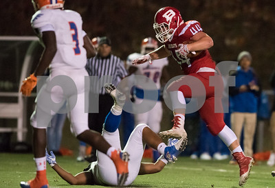 11/3/17  Wesley Bunnell | Staff  Bloomfield vs Berlin football on Friday night at Sage Park. Zachary Hrubiec (44) leaps over a defender on the run.