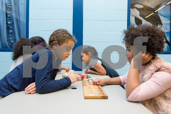 11/6/17 Wesley Bunnell | Staff Mancala was the game of the night for members of the New Britain Boys & Girls Club on Monday evening. Ruby Narvaez, L, plays Frecheline Garrido.