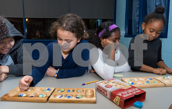 11/6/17 Wesley Bunnell   Staff Mancala was the game of the night for members of the New Britain Boys & Girls Club on Monday evening. Christian Narvaez, L, looks on as sister Ruby plays in a game and Nialise McDaniel looks on as Janiya Weston plays.
