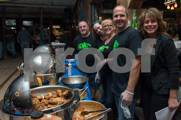 11/6/17 Wesley Bunnell   Staff The Southington Chamber of Commerce held their 12th annual Wing Fest on Monday evening at The Cadillac Ranch. Staff from The Groggy Frog who would eventually take 1st place. Nancy Brummett, 2nd from L, Sue DePaolo, Mark Montana & Cathy Kaczor.