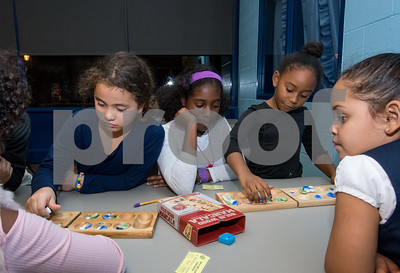 11/6/17  Wesley Bunnell | Staff  Mancala was the game of the night for members of the New Britain Boys & Girls Club on Monday evening. Ruby Narvaez plays in a game next to Nialise McDaniel as she looks on as Janiya Weston plays.