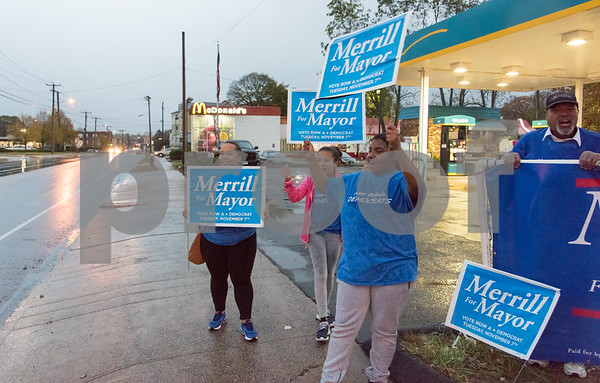 11/6/17 Wesley Bunnell | Staff Supporters of mayoral candidate Merrill Gay stand in the rain on the corner of West Main & Corbin Ave on Monday afternoon ahead of Tuesday's elections. Marsha Michaud, Mariah Santiago, Adrianna Luciano and alderman candidate Brian Keith Albert.