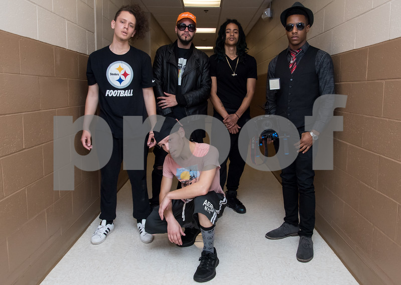 11/6/17  Wesley Bunnell | Staff<br /> <br /> Hoping to make it as the next big boy band members of We Are V1ral, WAVE, practice at The Boys & Girls Club on Monday evening. Members Dimas, L, manager Stevey Newnez, member Lokz, videographer DT of B&D Visual Entertainment and Shoog, front.