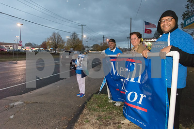11/6/17  Wesley Bunnell | Staff  Supporters of mayoral candidate Merrill Gay stand in the rain on the corner of West Main & Corbin Ave on Monday afternoon ahead of Tuesday's elections.  Isabella Cancel, L,  alderman candidate Brian Keith Albert, Yvonne Muniz and Edgar Lopez.