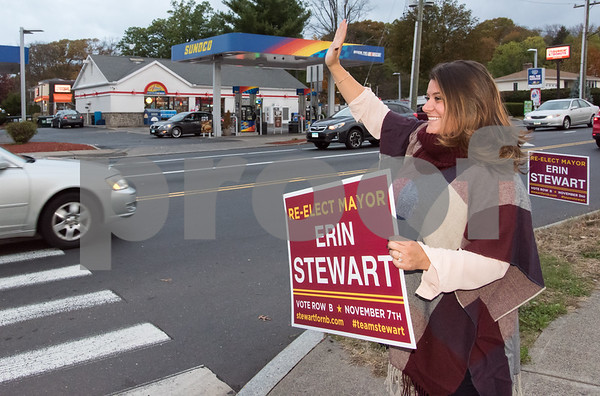 11/6/17 Wesley Bunnell | Staff Mayor Erin Stewart waves to motorists on the corner of West Main & Corbin Ave on Monday afternoon ahead of Tuesday's elections.