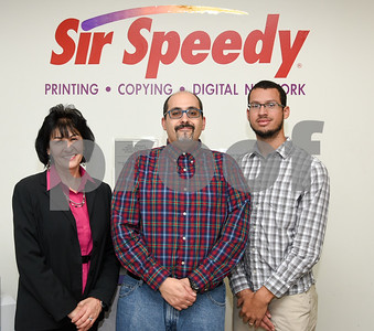 11/6/17  Wesley Bunnell | Staff  Sir Speedy owner Maria Bernacki, store manager Carlos Couto and customer service and marketing Josh Cubilete.  Missing from the photo is graphic designer Sara Michaud.