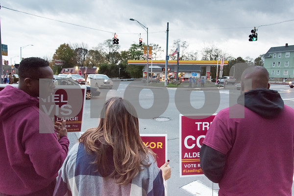 11/6/17 Wesley Bunnell | Staff Alderman Daniel Davis, Mayor Erin Stewart and Alderman Tremell Collins stand on the corner of West Main & Corbin Ave on Monday afternoon ahead of Tuesday's elections across from supporters of mayoral candidate Merrill Gay.