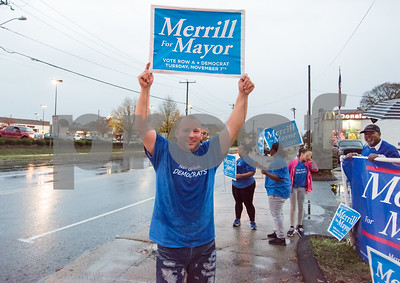 11/6/17  Wesley Bunnell | Staff  Candidate for alderman Francisco Santiago holds up a sign during a sudden rain storm on the corner of West Main & Corbin Ave on Monday afternoon ahead of Tuesday's elections.