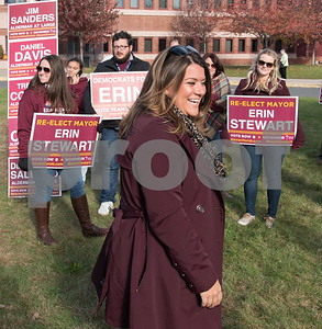 11/7/17  Wesley Bunnell | Staff  Incumbent Mayor Erin Stewart speaks to supporters including Alexia Fliss, L, Mathew Malinowski and Nicole Pac outside Slade Middle School on Tuesday morning before heading inside to vote.