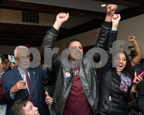 11/7/17 Wesley Bunnell | Staff Team Stewart at their election night headquarters at The Back Nine Tavern at Stanley Golf Course. Alderman Kristian Rosado reacts to winning re-election while standing next to Alderman Daniel Salerno.