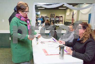 11/7/17  Wesley Bunnell | Staff  Democratic candidate for mayor Ellen Zoppo-Sassu checks in to vote with the help of Checker Sandy McCauley at the Elks Club on Tuesday at noon.