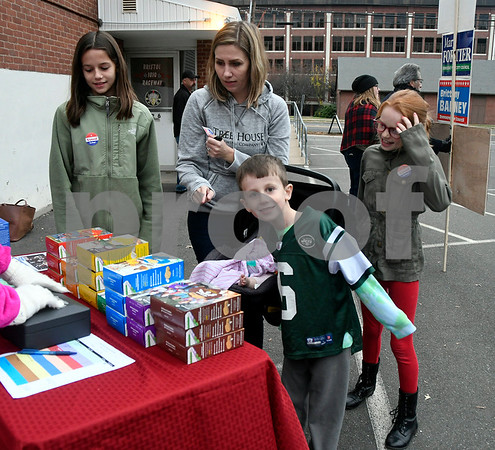 11/7/2017 Mike Orazzi | Staff Colleen Dolan buys Girl Scout cookies after voting with her children Nadia and Declan Brenna and in the car seat Sloane in the at the Elks Club in Bristol Tuesday.