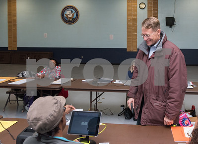11/7/17  Wesley Bunnell | Staff  Democratic candidate for Mayor Merrill Gay registers to vote with the help of official checker Elaine Rocker at the VFW on Tuesday morning.