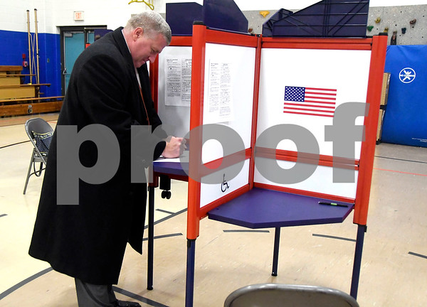 11/7/2017 Mike Orazzi | Staff Bristol Mayor Ken Cockayne while voting at the South Side School Tuesday.