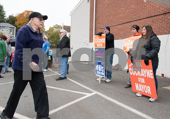 11/7/17 Wesley Bunnell | Staff A voter walks past supporters of both Democratic challenger Ellen Zoppo-Sassu and Incumbent Mayor Ken Cockayne into the Elks Club on Tuesday afternoon.