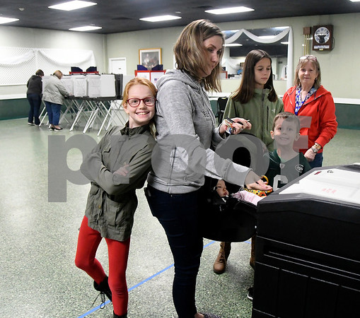 11/7/2017 Mike Orazzi | Staff Colleen Dolan while voting with her children Brenna, Nadia, Declan and in the car seat Sloane at the Elks Club in Bristol Tuesday.