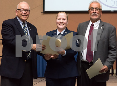 11/09/17  Wesley Bunnell | Staff  CCSU held a Veterans Day Observance Ceremony on Friday afternoon in Alumni Hall. Alderman Don Naples, L, and Alderman Daniel Salerno, far R, present CCSU student and CT Air National Guard Staff Sergeant Dorota Gdula with an award from the city.