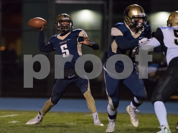 11/09/17 Wesley Bunnell | Staff Newington football hosted East Hartford on Friday night. Roberto Sanchez (5) passes.