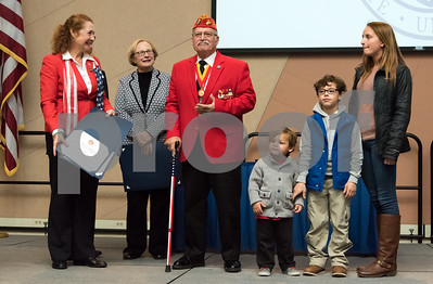 11/09/17  Wesley Bunnell | Staff  CCSU held a Veterans Day Observance Ceremony on Friday afternoon in Alumni Hall. CCSU alumn and Marine Corps veteran Salvatore V. Sena Sr., center,  receives a certificate of achievement from Congresswoman Elizabeth Esty, L, State Senator Terry Gerratana as his grandsons Zachary Sena, age 3, James David Sena, age 9 and granddaughter Kelsey Sena who is a current senior at CCSU.