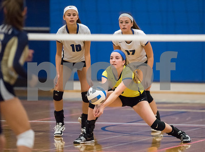 11/1/17  Wesley Bunnell | Staff  Southington girls volleyball defeated Platt Tech on Wednesday night at Southington High School.  Lynsey Danko (28) is back dup by Jenna Martin (10) and Brooke Cooney (17).