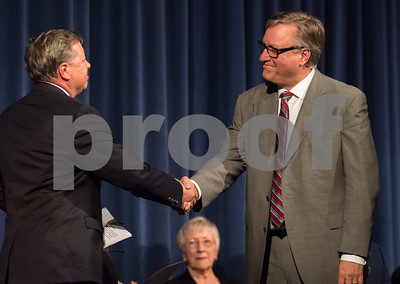 11/13/17  Wesley Bunnell | Staff  The City of Bristol held their 2017 Inaugural on Monday evening at Bristol Eastern High School. City Council for District 1 Gregory Hahn, R, shakes hands with David Preleski after the oath.