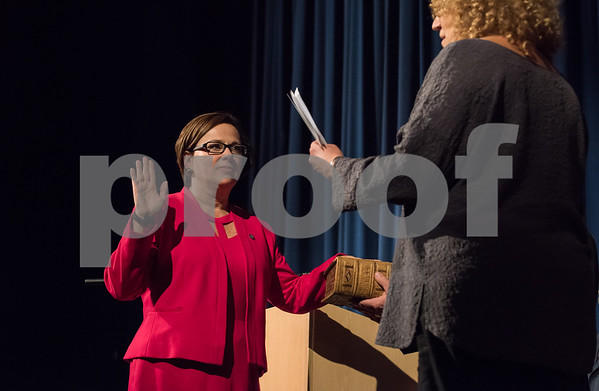 11/13/17 Wesley Bunnell | Staff The City of Bristol held their 2017 Inaugural on Monday evening at Bristol Eastern High School. Mayor Ellen Zoppo-Sassu with her hand on a family bible takes the oath administered by Dr. Amy Breakstone.