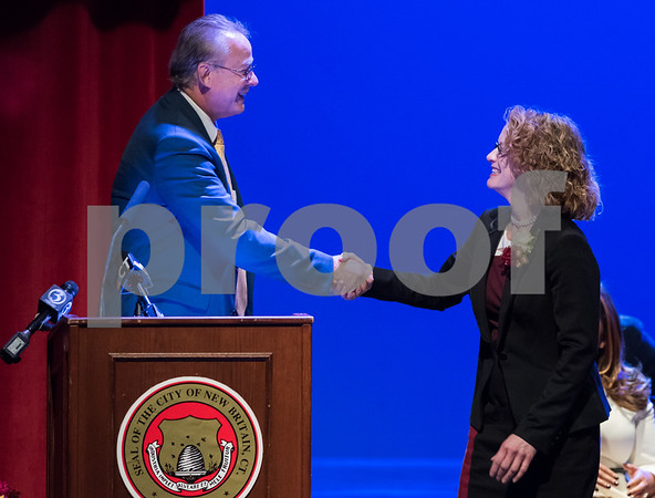 11/14/17 Wesley Bunnell | Staff The inauguration of Mayor Erin E. Stewart and other elected officials was held on Tuesday morning at New Britain High School. Town and City Clerk Mark H. Bernacki shakes hands with Tax Collector Cheryl S. Blogoslawski after the oath.