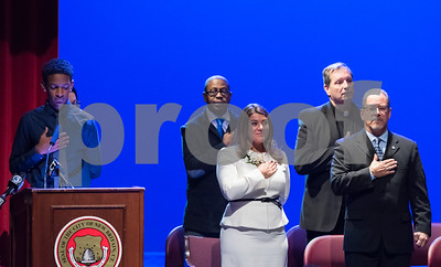 11/14/17  Wesley Bunnell   Staff  The inauguration of Mayor Erin E. Stewart and other elected officials was held on Tuesday morning at New Britain High School.  Mayor Erin Stewart stands next to her father and former mayor Tim Stewart during the Pledge of Allegiance led by student ambassador Dylan Washington, L,